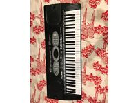 Almost perfect condition, hardly used, 61 key electronic keyboard
