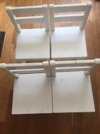 4 White wooden children's chairs