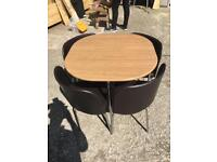Space saver table and 4 chairs.