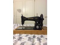 SINGER SEWING MACHINE. Almost new with engine and pedal attached. GRAB A BARGAIN.