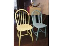 2 solid wood Windsor style chairs