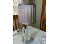 Chrome table lamp with grey pleated shade from Next