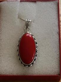 Ladies pendant and chain with a coral stone hallmarked 925 new
