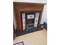 Decorative tiled pine surround fireplace