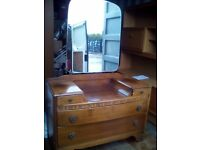 Retro oak dresser with mirror and drawers.