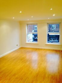 Light and airy 2 Bed in the heart of Cheam Village with secure parking
