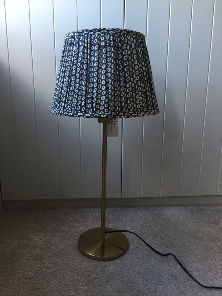 Black And White Pooky Lamp Shade Paired With Gold Finish Base