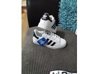 Adidas superstars. Brand new with tags size 4