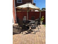 Garden table with 'lazy susan' and 6 recliner chairs