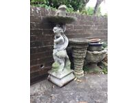 Stone statue and stone bird feeder plus various stone pots job lot