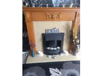 Solid oak and heavy marble electric fire