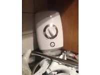 New unused triton 8.5kw electric shower