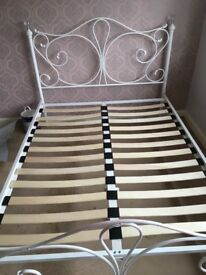Double bed white metal tubular frame good condition.