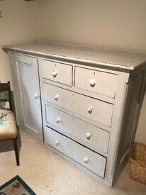 painted chest of drawers with a hanging compartment