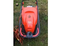 Lawnmower and petrol brush trimmer