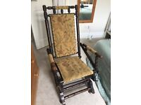 Antique wooden rocking chair, newly upholstered