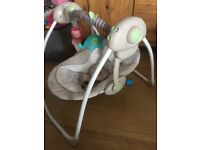 Neutral colour baby swing with music and toy bar in excellent condition