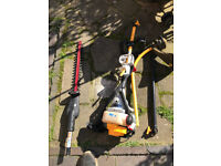 Ryobi petrol strimmer with attachments
