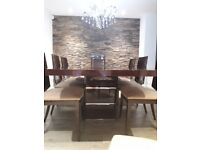 Beautiful Furniture Village Dining Tsble and 8 Chairs immaculate condition.