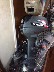 Suzuki 25hp outboard motor 2 stroke