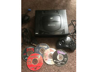 Sega Saturn console with games