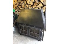 Traditional wood burning stove with back boiler