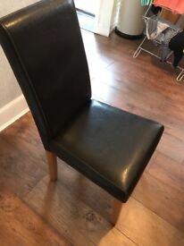 Extending dining room table and 4 faux leather chairs