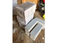 3 boxes of grey wall tiles