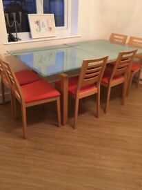 John Lewis Calligaris glass dining table 6 chairs and easily extends, expensive to buy.