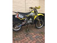 Suzuki RM85 motorcycle small wheel 2010 with MX kit and safety gear £1300ono