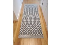 Patterned woven rug