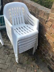 8 white plastic chairs, need a clean £10 for all
