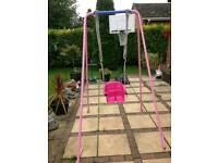Pink garden swing