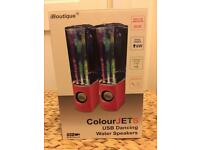 Pink colour jets light display Speakers