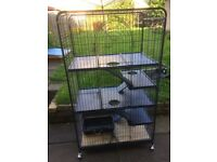 Three tier ferret cage with toys, bedding and food
