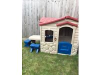 Little Tikes playhouse on the patio