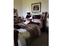 Double Bed with Mahoganny posts top and bottom/Dressing table and stool.