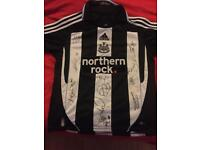 Newcastle signed shirt