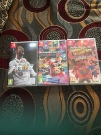 3 Ninetendon switch games,fifa18, street fighter etc