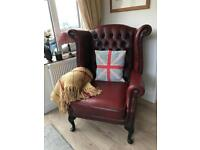 Oxblood wingback Queen Anne Chesterfield armchair. Can deliver