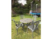 Wrought Iron Table with four Chairs