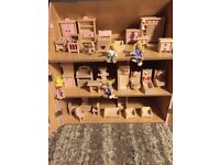 Large wooden fully furnished dolls house
