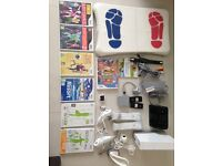 Nintendo Wii and Wii Fit board with games