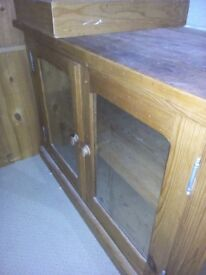 Glass front pin cupboard