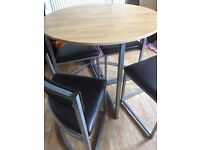 Round space saver table with 4 chairs