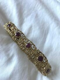 9ct gold bracelet with 10 gorgeous Ruby's 27g