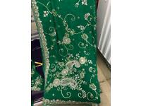 Brand NEW party wear emerald green saree with heavy stonework and diamanté embroidery