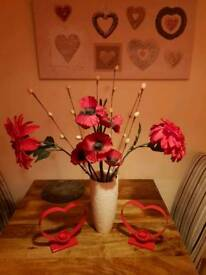 Red flowers and read hearts candles