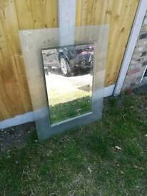 Mirror with translucent glass frame