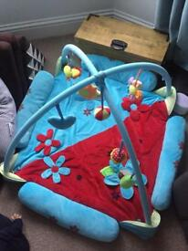 Large play gym with hanging toys